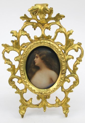 611: A BERLIN MINIATURE PORCELAIN OVAL PORTRAIT, the  b