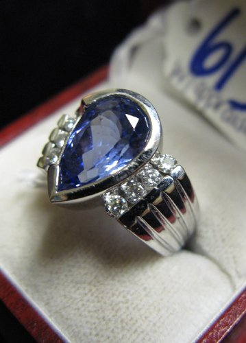 613: TANZANITE, DIAMOND AND FOURTEEN KARAT WHITE GOLD R