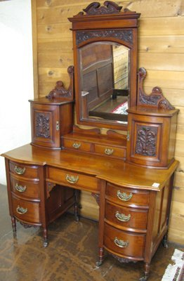 619: A VICTORIAN CARVED MAHOGANY VANITY, English,  last