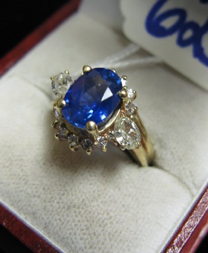 625: SAPPHIRE, DIAMOND AND FOURTEEN KARAT GOLD RING,  c