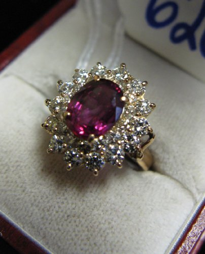 626: RUBY, DIAMOND AND FOURTEEN KARAT GOLD RING, set  w
