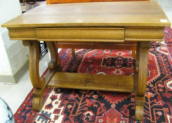 264: AN OAK EMPIRE REVIVAL LIBRARY TABLE, American,  c.