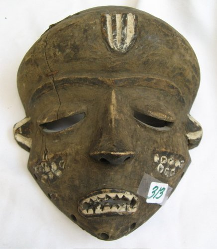 313: AN AFRICAN HAND CARVED FACE MASK with traces of  w