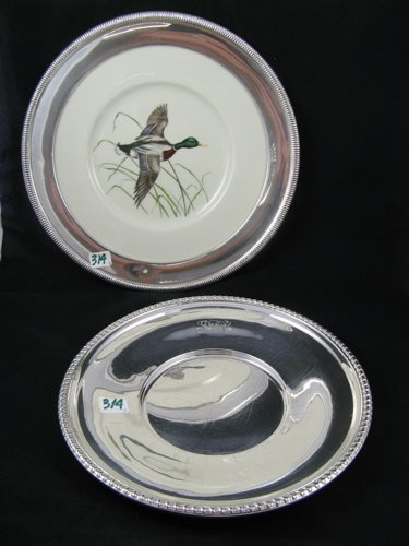 314: TWO STERLING SILVER PLATES.  One a hand colored  s