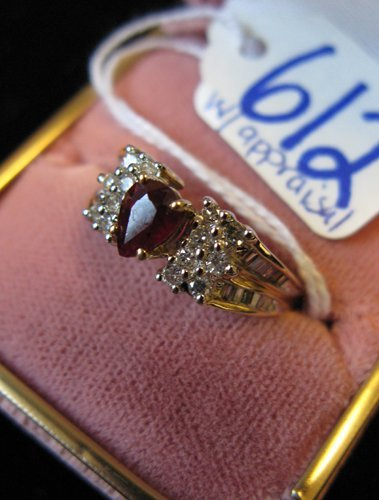 612: RUBY, DIAMOND AND FOURTEEN KARAT GOLD RING WITH  A