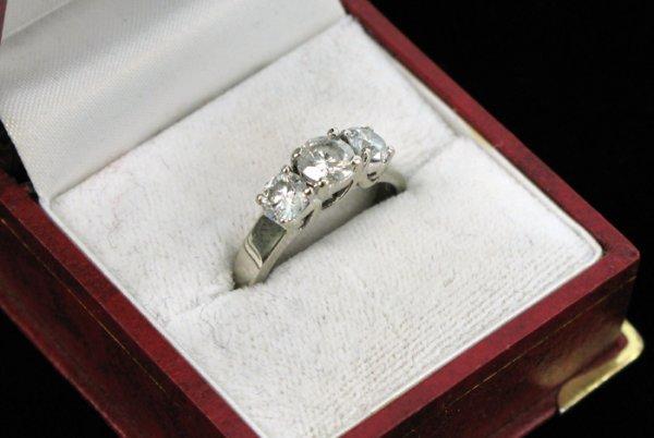 613: DIAMOND AND FOURTEEN KARAT WHITE GOLD THREE  STONE