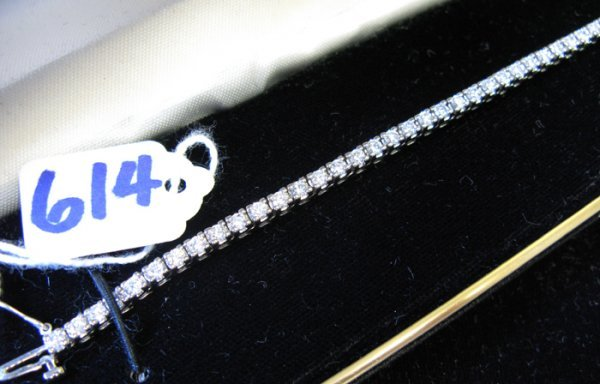 614: DIAMOND AND FOURTEEN KARAT WHITE GOLD TENNIS  BRAC