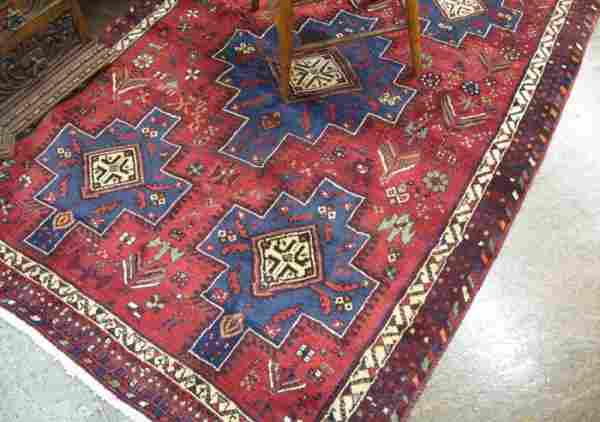 844: PERSIAN SIRJAN AREA RUG, the red field featuring a