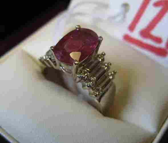 121: RUBY, DIAMOND AND FOURTEEN KARAT WHITE GOLD  RING.