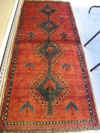 319: PERSIAN SHIRAZ RUNNER, the plain red field  featur