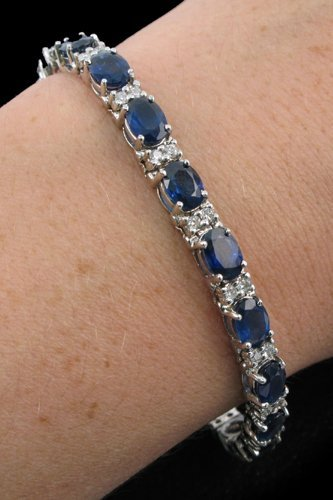 614: SAPPHIRE, DIAMOND AND FOURTEEN KARAT WHITE GOLD  B