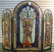 731: A DECORATIVE STAINED AND LEADED GLASS FIREPLACE S