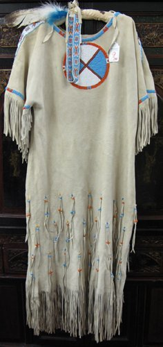 9: AN AMERICAN INDIAN MADE BUCKSKIN DRESS AND HEAD BAN