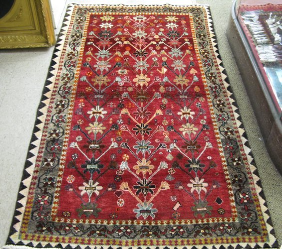 12: PERSIAN SHIRAZ AREA RUG, overall floral design on