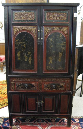 16: CHINESE MING STYLE CABINET, having two panel doors