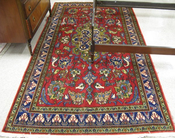 20: PERSIAN ARAK CARPET, floral and central floral med
