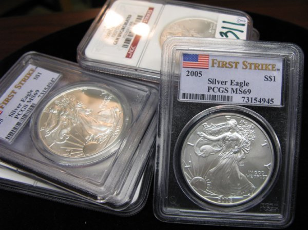 311: 311: EIGHT U.S. SILVER EAGLE DOLLARS: 2003 (1), NG
