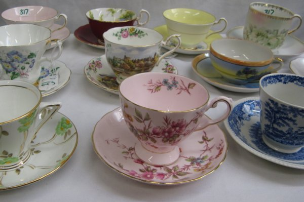 317: 317: SIXTEEN ASSORTED TEACUPS AND SAUCERS; floral