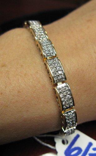613: 613: DIAMOND AND FOURTEEN KARAT YELLOW AND WHITE G
