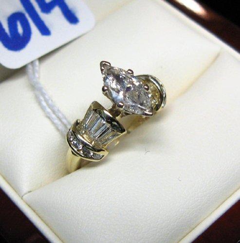 614: 614: DIAMOND AND FOURTEEN KARAT GOLD RING, centeri