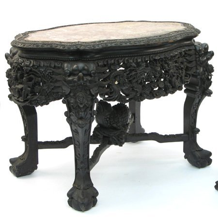 694: 694: A HIGHLY CARVED TEAKWOOD CENTER TABLE, Chines