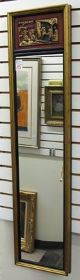15: A CHINOISERIE VERTICAL WALL MIRROR having a  carved