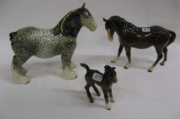 317: A GROUP OF THREE GLAZED PORCELAIN EQUESTRIAN  FIGU