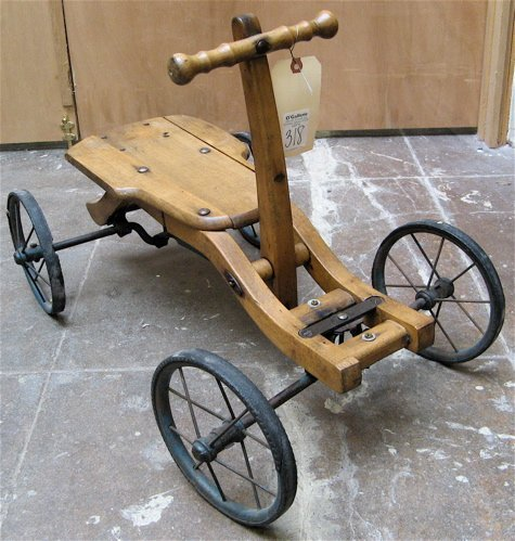 318: CHILD'S WOOD AND IRON PUSH/PULL CART, the frame  o