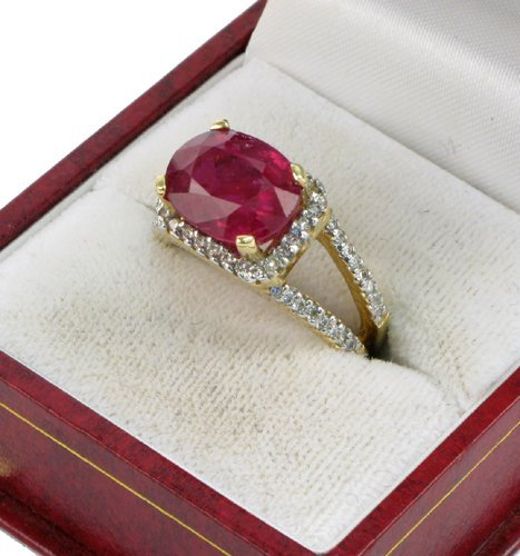 614: RUBY, DIAMOND AND FOURTEEN KARAT GOLD RING WITH  A