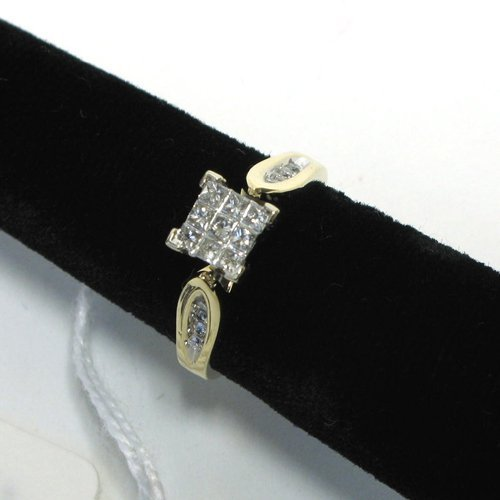 1003: DIAMOND AND FOURTEEN KARAT GOLD RING, centering a