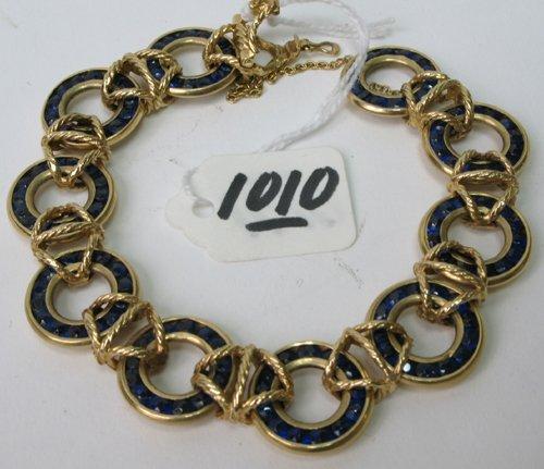 1010: BLUE SAPPHIRE AND FOURTEEN KARAT GOLD BRACELET,