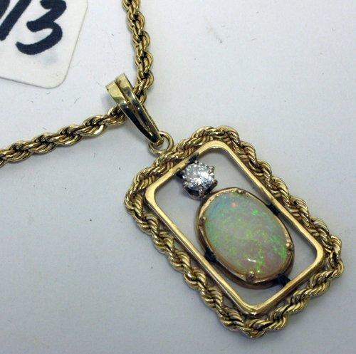 1013: OPAL, DIAMOND AND FOURTEEN KARAT GOLD PENDANT  NE
