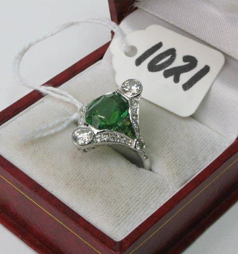 1021: GREEN TSAVORITE GARNET, DIAMOND AND EIGHTEEN  KAR