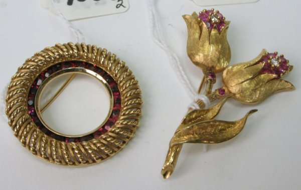 1031: TWO RETRO FOURTEEN KARAT GOLD AND RUBY BROOCHES:
