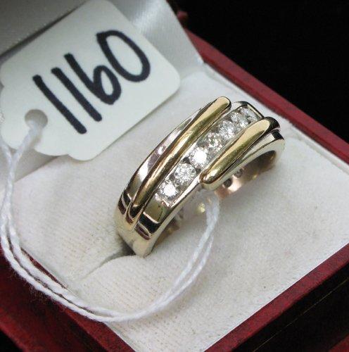 1160: MAN'S DIAMOND AND FOURTEEN KARAT GOLD RING, set