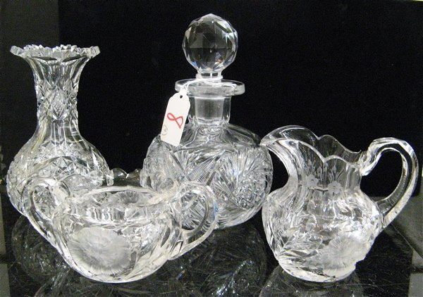 8: FOUR AMERICAN CUT CRYSTAL TABLE ACCESSORIES. One is