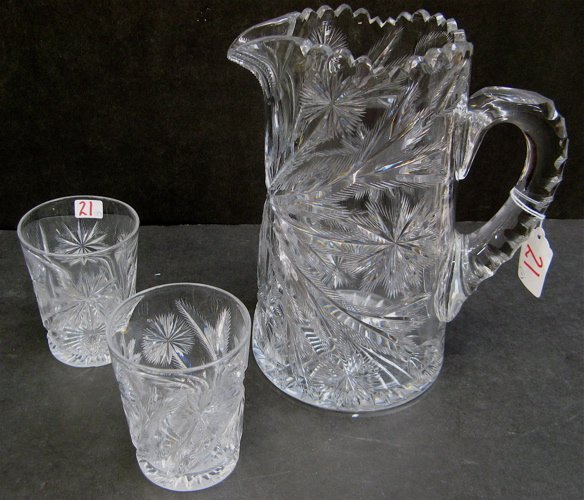 21: THREE PIECE LIBBEY SIGNED CUT CRYSTAL DRINK SET, in
