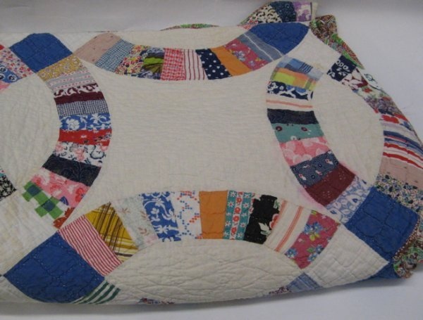 323: AMERICAN HANDMADE AND QUILTED PATCHWORK QUILT, in