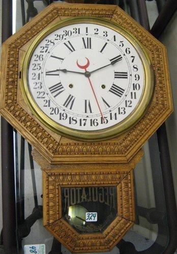 """324: OAK SCHOOL HOUSE WALL CLOCK, E. Ingraham Co.,  """"Ma"""