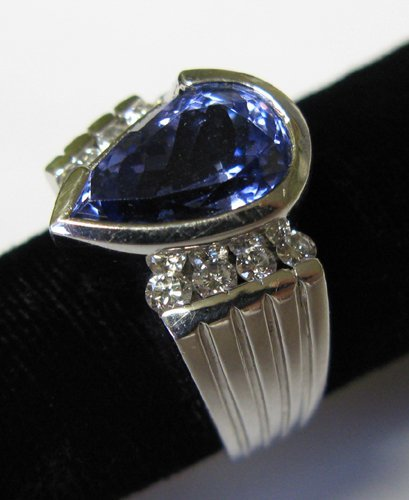 614: TANZANITE, DIAMOND AND FOURTEEN KARAT WHITE GOLD R
