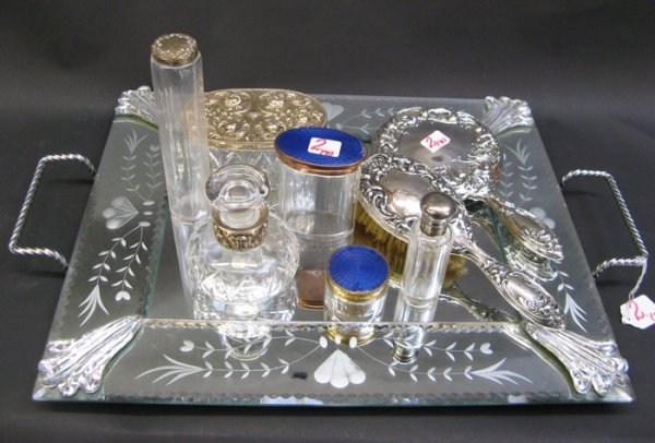 2: AN ENGRAVED MIRROR TOP DRESSING TRAY, footed,  with