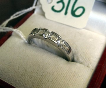 316: DIAMOND AND PLATINUM RING, the narrow band set  wi