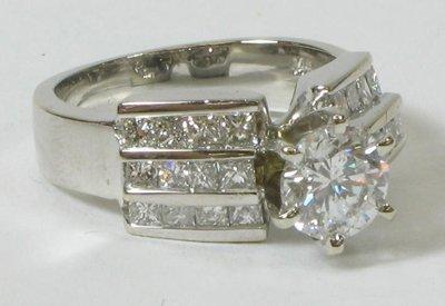 613: DIAMOND AND FOURTEEN KARAT WHITE GOLD RING