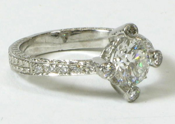 625: DIAMOND AND EIGHTEEN KARAT WHITE GOLD RING WITH  A