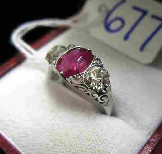 677: RUBY, DIAMOND AND EIGHTEEN KARAT WHITE GOLD  RING,