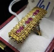 761 RUBY DIAMOND AND NINE KARAT GOLD RING set with s