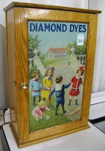 "310: AN OAK ""DIAMOND DYES"" CABINET, American, early  20"