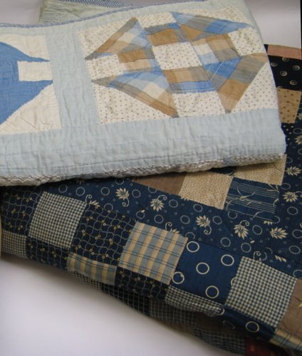 311: TWO AMERICAN PIECED PATCHWORK QUILTS. One in a  mu