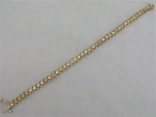 7: DIAMOND AND FOURTEEN KARAT GOLD BRACELET, with  43 r