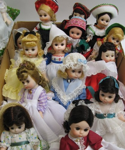314: GROUP OF 21 MADAME ALEXANDER DOLLS, with original
